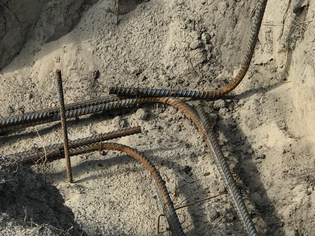 Steel rebar bent 90-degrees laid in the footing